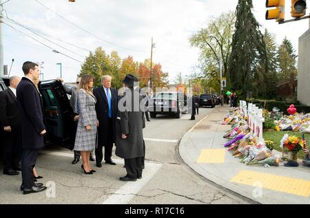 U.S President Donald Trump and first lady Melania Trump, are greeted by Rabbi Jeffrey Myers, right, as they arrive at  the memorial of those killed at the Tree of Life Synagogue October 30, 2018 in Pittsburgh, Pennsylvania. Son-in-law Jared Kushner looks on from the left. - Stock Photo