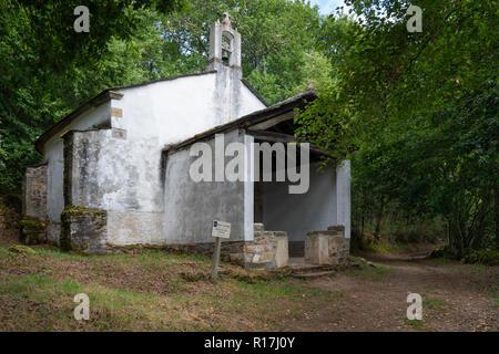 GRANDAS DE SALIME, SPAIN - AUGUST 25, 2018: Old chapel San Lazaro in the forest of Padraira, Camino de Santiago close to Grandas de Salime on August 2 - Stock Photo