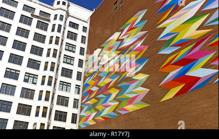 'Constellation' by Odili Donald Odita is painted on the side of the brick Halle Brothers parking garage across from the Halle Building in Cleveland. - Stock Photo