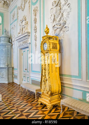 18 September 2018: St Petersburg, Russia - Gilded clock in the Peterhof Grand Palace. - Stock Photo
