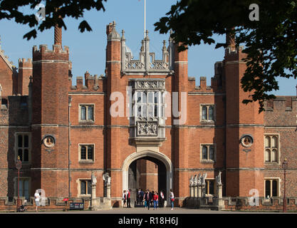 Tourists at main entrance of Hampton Court Palace, East Molesey, Surrey - Stock Photo