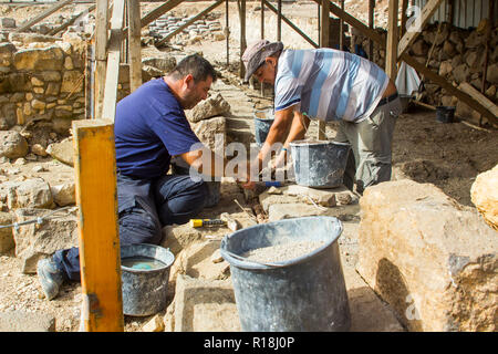 4 May 2018 Tradesmen doing restoration work on a recently discovered site at the ancient village of Magdala in Galilee Israel. - Stock Photo