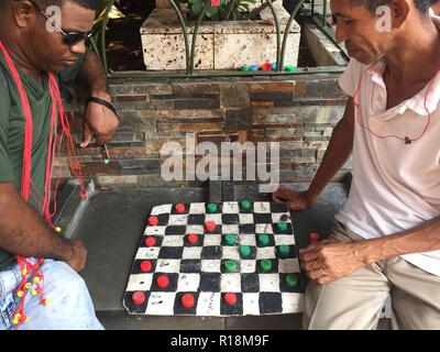 Cartagena, Colobia - march 2018: Two men playing checkers on street in Capurgana, Colombia - Stock Photo
