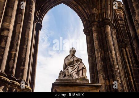 Statue of Sir Walter Scott on the Scott Memorial, Princes Street, Edinburgh, Scotland - Stock Photo