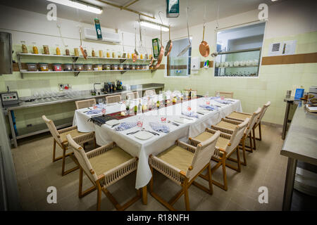 Table set up for dinner, interior of kitchen made for special dinners. Private restaurant room, scene - Stock Photo