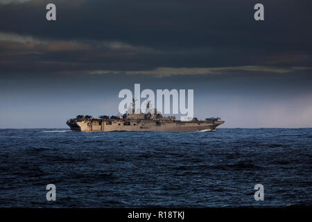 USS Iwo Jima assault carrier of the US Navy with tilt rotor V22 Osprey US Marine Corps aircraft embarked - Stock Photo