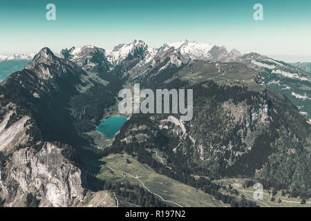 Panorama view of Alpstein mountain with lake of Seealp. Canton of Appenzellerland, Switzerland - Stock Photo