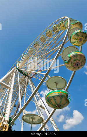 BERLIN, GERMANY - JULY 13, 2018: Ferris wheel against clear blue sky in Tiergarten park. Berlin is the capital and largest city of Germany by both are - Stock Photo
