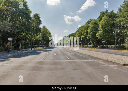 BERLIN, GERMANY - JULY 13, 2018: People visit summer Tiergarten park with Victory column in the background. Berlin is the capital and largest city of  - Stock Photo