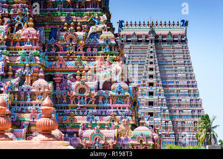 Gopurams in Sri Ranganathaswamy Temple, India. A Gopuram is a monumental gatehouse tower, usually ornate, at the entrance of a Hindu temple - Stock Photo