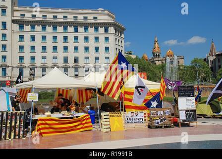 Campaigners for the Llibertat Presos Politics (Free Political Prisoners) movement campaign in Placa Catalunya in Barcelona, Spain on April 17, 2018. - Stock Photo