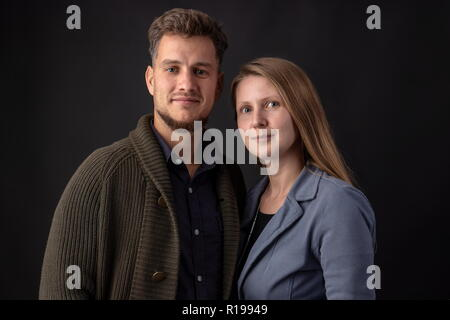 Portrait in the studio of two young business partners standing face to face - Stock Photo