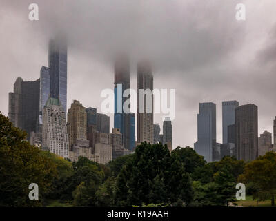 Billionaires' Row view from Central Park in Manhattan, New York City on a foggy day. - Stock Photo