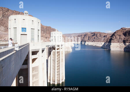the reservoir behind Hoover Dam and the water towers. The cliffs discoloration shows how much Lake Mead has receded in level - Stock Photo
