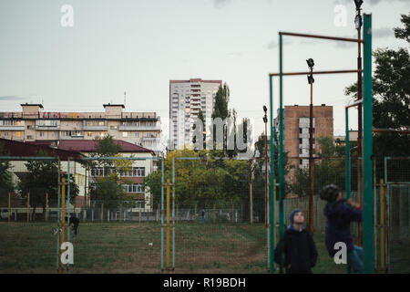 Ghetto architecture the collapse of the Soviet Union. Echo of the USSR. Country high-rise houses in the evening in Obolon district in the city of Kiev - Stock Photo