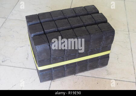 Brown coal briquette stockpile as an alternate heating source for fireplace or even for an solid fuel oven heating the whole house. - Stock Photo