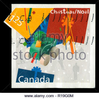 Postmarked stamp from Canada in the  Christmas (2003), Gifts series - Stock Photo