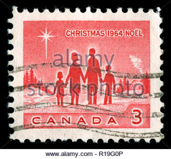 Postmarked stamp from Canada in the  Christmas 1964 series, - Stock Photo