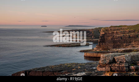 Cliffs at Deerness Nature reserve , Mainland Orkney at sunrise. - Stock Photo