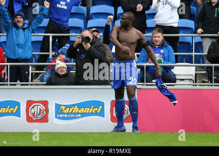Cardiff, UK. 10th Nov, 2018. Sol Bamba of Cardiff city takes off his shirt as he celebrates after scoring his teams 2nd goal. Premier League match, Cardiff City v Brighton & Hove Albion at the Cardiff City Stadium on Saturday 10th November 2018. this image may only be used for Editorial purposes. Editorial use only, license required for commercial use. No use in betting, games or a single club/league/player publications. pic by Andrew Orchard/Andrew Orchard sports photography/Alamy Live news Credit: Andrew Orchard sports photography/Alamy Live News - Stock Photo