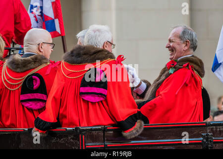 London, UK. 10th Nov, 2018. Aldermen - The new Lord Mayor (Peter Estlin, the 691st) was sworn in yesterday. To celebrate, today is the annual Lord Mayor's Show. It includes Military bands, vintage buses, Dhol drummers, a combine harvester and a giant nodding dog in the three-mile-long procession. It brings together over 7,000 people, 200 horses and 140 motor and steam-driven vehicles in an event that dates back to the 13th century. The Lord Mayor of the City of London rides in the gold State Coach. Credit: Guy Bell/Alamy Live News - Stock Photo