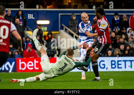 London, UK. 10th Nov, 2018. Daniel Bentley of Brentford saves during the EFL Sky Bet Championship match between Queens Park Rangers and Brentford at the Loftus Road Stadium, London, England on 10 November 2018. Photo by Salvio Calabrese. Editorial use only, license required for commercial use. No use in betting, games or a single club/league/player publications. Credit: UK Sports Pics Ltd/Alamy Live News - Stock Photo