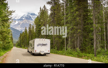 MOUNT ROBSON, BRITISH COLUMBIA, CANADA - JUNE 2018: Camping trailer being towed along a road in the Mount Robson Provincial Park in British Columbia,  - Stock Photo