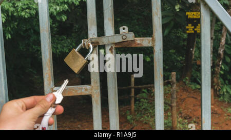Key to a lock to the secret water fall entry in Costa Rica - Stock Photo