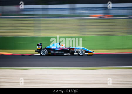 Vallelunga, Rome, Italy september 16 2018, Aci racing weekend. Formula 4 racing pink car at turn during the race, blurred motion background - Stock Photo