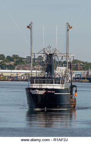 New Bedford, Massachusetts, USA - June 8, 2018: Commercial fishing boat Princess Scarlett, hailing port Cape May, New Jersey, heading out of New Bedfo - Stock Photo