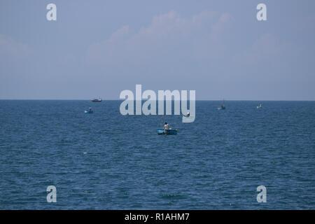 fisher boats in the sea at mui ne vietnam - Stock Photo