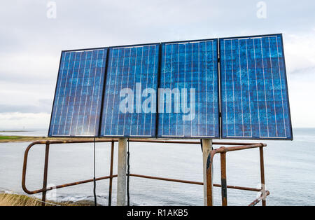 Solar panels on coast at Torness nuclear pwer station, East Lothian, Scotland, UK - Stock Photo