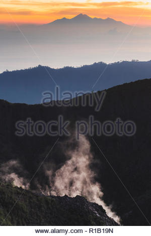 Beautiful sunrise from the top of Mount Batur - Bali, Indonesia - Stock Photo