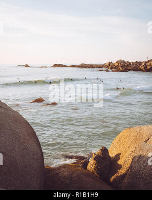 Lifestyle of camps bay at sunset with surfers - Stock Photo