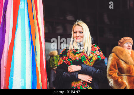 Gomel, Belarus - February 18, 2018: Beautiful young woman in Belarusian shawl at the Shrovetide fair in Gomel - Stock Photo