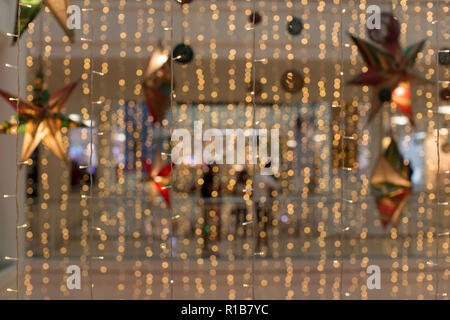 curtain of fairy lights LED in a Christmas decoration Shopping mall artistic abstract photo - Stock Photo
