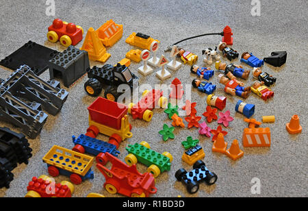 Duplo bricks are pictured on a living room carpet in a family home in Warwick, UK, on November 11, 2018. - Stock Photo