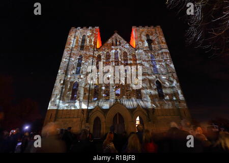 Ripon,North Yorkshire,UK. 10th November 2018. Ripon Cathedral puts on an illuminated projection display to mark armistice day 2018. The display shows still images from the war along with names of some of those who lost their lives. Animated poppies also cascade down the face of the cathedral where 1000's gathered to watch the final showing. Credit: Yorkshire Pics/Alamy Live News - Stock Photo