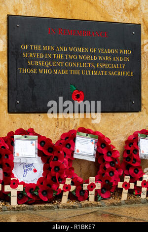 Yeadon, Leeds, West Yorkshire, UK 11th November, 2018. Close-up of the plaque inscription & crosses & poppy wreaths laid at the base of the new war memorial stone in front of Yeadon Methodist Church, on the anniversary of the end of the First World War. Ian Lamond/Alamy Live News - Stock Photo