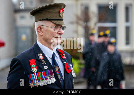 Saltcoats, Ayrshire, UK. 11th Nov, 2018. Heavy rain and strong winds didn't deter over 1000 people turning out at the Cenotaph and war memorial in Saltcoats, Ayrshire, UK to show their respects, lay tributes of wreathes and take part in the Remembrance Day Service commemorating 100 years since the cessation of conflicts in World War 1 Credit: Findlay/Alamy Live News - Stock Photo