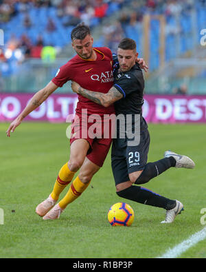 11th November 2018, Stadio Olimpico, Rome, Italy; Serie A Football, Roma versus Sampdoria; Kostas Manolas of Roma challenges Nicola Murru of Sampdoria - Stock Photo