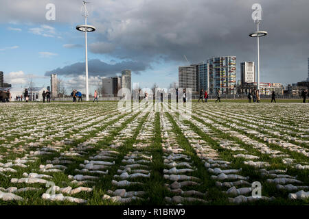 Stratford, London, UK. 11th November 2018. The Artist Rob Heard's installation representing the fallen soldiers from the First World War. Tens of thousands of shrouded figures  laid out at London's Olympic Park to mark the centenary of the end of World War One. Each handmade 12-inch model represents one of the 72,396 British Commonwealth serviceman killed at the Somme with no known grave.  In total, more than one million soldiers were killed or wounded during the 1916 Battle of the Somme.. Credit: Mike Abrahams/Alamy Live News - Stock Photo