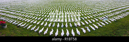 Queen Elizabeth Olympic Park, Stratford, London, UK - 11 November  2018: Shrouds of the Somme art installation which represents the 72,396 British Commonwealth servicemen killed at the Battle of the Somme who have no known grave, and whose names are engraved on the Thiepval Memorial seen in remembrance day Sunday 2018. Hundreds of people were silent for two minutes in honour of the fallen. The installation is made up of hand-sewing calico shrouds and bound over small figures by artist Rob Heard. Credit: David Mbiyu /Alamy Live News - Stock Photo