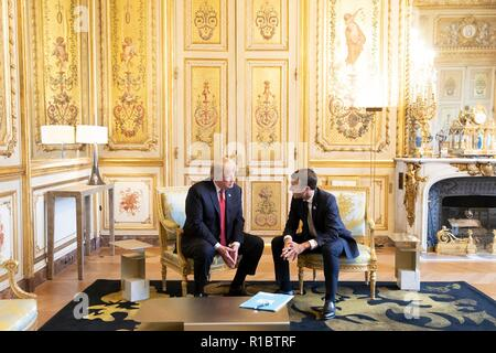 U.S President Donald Trump, left, during a bilateral meeting with French President Emmanuel Macron at the Elysee Palace November 10, 2018 in Paris, France. Trump is in France for commemorations marking the Centennial of the end of World War I. - Stock Photo