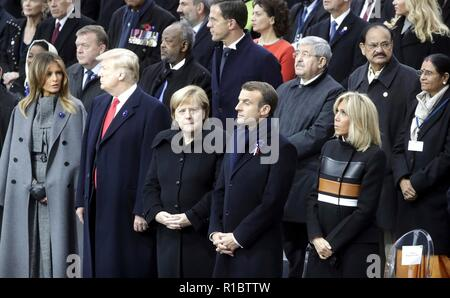 Paris, France. 11th Nov 2018. World leaders gathered before the start of events marking the Centennial of Armistice Day at the Arc de Triomphe November 11, 2018 in Paris, France. Standing from left to right in the front row are: U.S. First Lady Melania Trump, U.S. President Donald Trump, German Chancellor Angela Merkel, French President Emmanuel Macron and his wife Brigitte Macron. Credit: Planetpix/Alamy Live News - Stock Photo