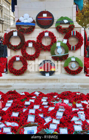 London, UK. 11th November 2018. Red Poppy wreaths and crowds at the Cenotaph on the100th anniversary of the First World War Armistice, Whitehall, London, UK Credit: Paul Brown/Alamy Live News - Stock Photo