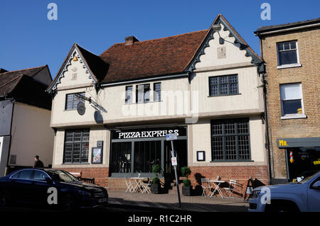 This plastered building was formerly the White Horse Inn, North Street. Bishops Stortford, Hertfordshire. Built around 1550 it was an inn - Stock Photo