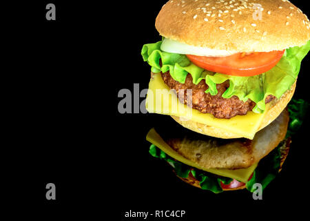 big hamburger with fresh vegetables with reflection isolated on black background - Stock Photo