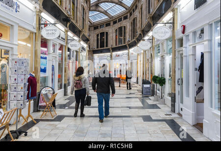 People walking through the Royal Arcade Shopping Centre, a small shopping mall in Worthing, West Sussex, England, UK. - Stock Photo