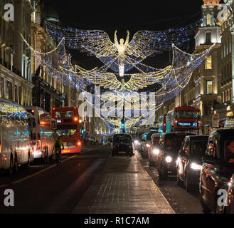 Christmas Angel Decorations above Regents Street, Central London, England, UK. Busses and cars also in street. Dec. 2016 - Stock Photo